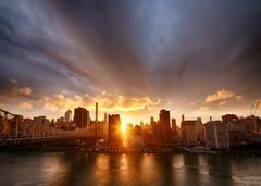 Manhattan Sunset (supra455) Tags: city nyc bridge blue sunset sky urban orange newyork reflection clouds river island us unitedstates manhattan roosevelt east hdr manhattanhenge sunstar