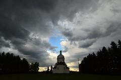 Heavens Opening (faithroxy) Tags: county sky cloud storm church weather clouds rural nikon catholic cross stormy alberta cupola domes ukrainian leduc immaculateconception 14mm calmar rokinon