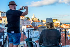 Shooting in Alfama (Kuba Abramowicz) Tags: lisboa lisbon portugal street streets alfama shooting shoot picture scenery scenic scene sky people nikon nikkor nikor d610 35mm clouds cloud cloudy square hat hats plaza sun sunset sunny city cityscape