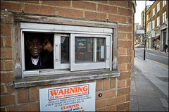 Portrait of a Parking Attendant (Sven Loach) Tags: street uk portrait england window smile warning nikon britain pavement working hoxton hackney sliding carpark eastlondon enforcer parkingattendant clamped d5100