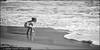Wait and Sea (karfax) Tags: boy sea bw france water canon bucket eau child noiretblanc cannes sable wave foam enfant plage écume seau