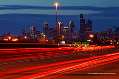 Seattle @ Sundown (TIA International Photography) Tags: road seattle county city blue light sunset red sky skyline buildings tia evening washington spring highway stream downtown king cityscape skyscrapers traffic motorway pacific northwest dusk route trail lamppost transportation freeway commute sound april puget tosin arasi tiascapes tiainternationalphotography