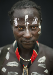 Painted Face And Chest Of Karo Man,  Omo Valley Ethiopia (Eric Lafforgue) Tags: africa portrait people lines vertical necklace artistic stripes picture tribal ornament photograph blackpeople omovalley bodypainting ethiopia tribe rite adultsonly frontview adornment colorphoto pigments nomadic eastafrica onepersononly humanface lookingatcamera manmen 8139 onemanonly onematuremanonly indigenousculture snnpr southernethiopia nomadicpeople truepeople exterioroutdoors 4549years korcho omotic 4044years southernnationsnationalitiesandpeoplesregion blackethnicity peoplesoftheomovalley karakarokerre bodypaintingnaturalpatterndesignritualbodyart whitepaintchalkpatternsdesignbodypaintingritualpow ethiopianomovalley abyssiniahornofafrica ethio8139 onematureadultonly