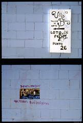 Missatges a les parets (Salva G.) Tags: barcelona film wall analog pen 35mm paint kodak olympus negative single frame half scanned ft pelicula asa halfframe f18 35 00 analogica dyptich analogic 38mm e100g singleframe diptico analogico diptic fzuiko pellicula