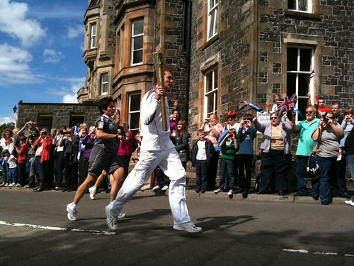 Myles Clark carries Olympic Flame through Tarbet