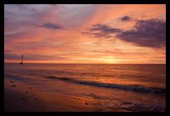 Last light over the irish sea (Ango82) Tags: sea sun beach clouds canon waves northwest wirral newbrighton merseyside irishsea eos40d