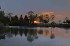 Early Morning Sunrise in Milwaukee Wisconsin 05-12-2012 (2sheldn) Tags: morning sky orange reflection water silhouette wisconsin sunrise canon early pond milwaukee wi allrightsreserved photomatix 550d t2i sheldn tamron1024 copyrightdanielsheldon 05122012 allrightsreserveddanielsheldon sheldnart