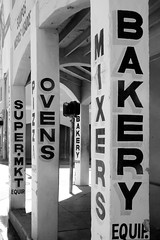 Old Miami (Burnt Umber) Tags: retail bakery oven store storefront column sign gaffiti miami florida downtown rpilla001 ©allrightsreserved black white blanco negra