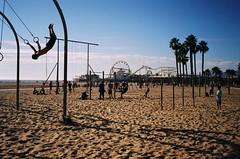 (LITTLEKIDS;,) Tags: ocean california santa shadow film beach analog 35mm pier losangeles sand kodak santamonica palmtrees rings monica ferriswheel rollercoaster workout