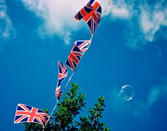 Flags, Bubbles & Branches (Ryan J. Nicholson) Tags: life street blue trees decorations party summer england sky color nature weather clouds vintage jack flying nikon village wind britain jubilee flag branches yorkshire union great banner decoration deep style bubbles retro diamond east celebration riding bubble string marsh dslr flapping liquid tone tonal cooling fairly barmby