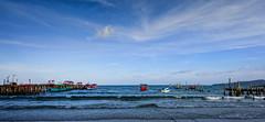 walking next to seaside  Suna Cho (SUNA_PHOTOGRAPHY) Tags: travel blue sea summer sky beach water skyline clouds landscape coast boat seaside nikon cambodia heaven waterfront wave bluesky shore kohrong