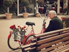 For the romantics... (Argyro...) Tags: street red roses people man flower bike bench elderly