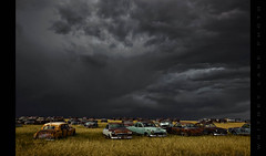 The Gathering (Whitney Lake) Tags: storm cars abandoned clouds junk rust decay ominous threatening junkyard prairie omen