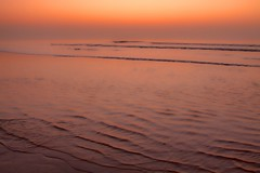 Orange Rhapsody (dorrisd) Tags: sea orange seascape holland beach water coast zonsondergang raw mood colours coldplay noordzee sunsets peaceful tranquility zee romantic ripples katwijk oranje topaz zuidholland kleuren zeegezicht sfeer romantisch fixyou canon24105mm canoneos50d andeweg lightroom3 rimpelingen dorrisd mieneke
