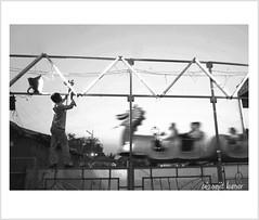 Mela.. (b i s w a j i t) Tags: street india festival geometry culture kolkata mela slowshutterspeed joyrides dragonride stillandmovement