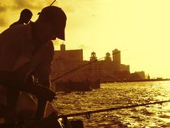 Pescando al atardecer.- (ancama_99(toni)) Tags: sunset summer vacation yellow sepia sunrise atardecer gold dawn nikon cuba sunsets amanecer atardeceres sunrises vacaciones ocaso 2012 lahabana amaneceres centrohabana 10favs 10faves 25favs 25faves blinkagain