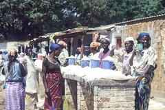 Women selling gari in a market (IITA Image Library) Tags: women gari cassava traders manihotesculenta