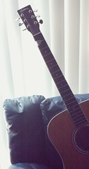 Acoustic Guitar On Couch