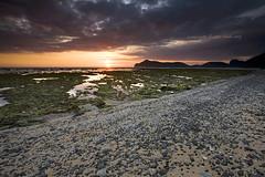 Sandy stony beach (Randi Ang) Tags: sunset sea seascape west beach stone canon indonesia landscape eos asia south east 5d ang randi barat sumbawa sekongkang rantung