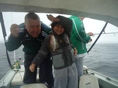 marcelo e seu filho em uma pescaria.,
