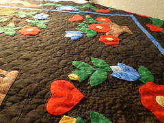 closeup of quilting on first applique quilt