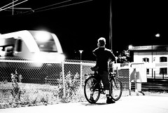Day 236 - Night Train (dennisdasfoto) Tags: street blackandwhite bw oneaday bike bicycle night train fence project blackwhite waiting nacht sweden schweden streetphotography zug photoaday sverige 365 zaun fahrrad natt wachten pictureaday cykel staket tg 366 svartvitt kristinehamn schwarzweis gatu project365 vntar 365days 3651 gatufoto project3651 gatufotografi project366 project365236 strasenfotografie stphotographia dt50mmf18sam project365082312 project36523aug12