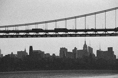 Empire State Building And The Chrysler Building as Seen Under The George Washington Bridge; Viewed From New Jersey, US (hogophotoNY) Tags: city nyc bridge blackandwhite bw usa ny building slr film skyline analog truck 35mm canon buildings us blackwhite skyscrapers unitedstates kodak grain landmarks landmark scan iso 35mmfilm scanned empirestatebuilding trucks filmcamera asa grainy chryslerbuilding expired 35 3200 analogphotography span highspeed georgewashingtonbridge gwbridge cityskyline hispeed highiso filmgrain expiredfilm kodakfilm 3200iso filmphotography landmarkbuilding 3200asa 3200film canonelaniie filmphoto 3200speedfilm newyorkbridge landmarkbuildings bridgespan hiiso canonfilmslr hogo expiredkodakfilm kodak3200film expiredbwfilm hogophoto expired35mmfilm expired35mmkodakfilm canonelaniiecamera