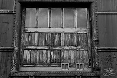 Baggage (mdrew70) Tags: door wood blackandwhite canada train railway alberta baggage weatherd