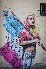 Parisian Grafitti (eddy.kamalsky) Tags: street city travel blue red urban white paris france art girl beautiful canon cutout grafitti d70 flag protest can spray jeans backpacking liberte humanite galit