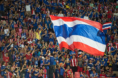 BANGKOK-THAILAND-5JUNE,2016:Unidentified fans of Thailand supporters in action during match between match Kings cup between Thailand and Jordan at rajamangkala Stadium in Thailand on 5 june 2016 (leykladay) Tags: world portrait people man motion sport club ball thailand person moving football goal movement fighter play action kick stadium fifa soccer group competition player line thai editorial match fans league cheering champions supporters active kingcup tpl