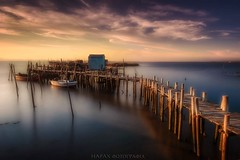 Longing for the past (Blai Figueras) Tags: longexposure sunset sea sky panorama sun lake seascape portugal water clouds ro wow reflections river landscape puente atardecer seaside flickr horizon atmosphere delta paisaje le cielo eden paraiso silkeffect