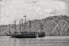 Pirates (mtudis) Tags: phaselis xt1 fujifilm fuji xf18135mm pirate sea seaside bnw blackandwhite ship mountain antalya