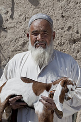 Old man with goat 3619 (shahidul001) Tags: old pakistan portrait people man color colour male vertical beard daylight asia day elderly pakistani aged calf drik southasia quetta balochistan drikimages goatcalf
