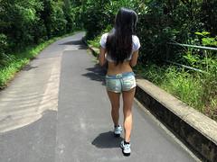 A Walk in the Park (globetrekimages) Tags: road park people woman girl beautiful asian person hongkong model legs path walk explore denim shorts explored