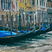 Gondolas moored in front of Renaissance era buildings along the Grand Canal in Venice