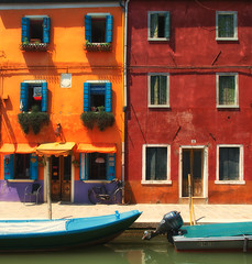 Colorful houses on the island of Burano (Sorin Popovich) Tags: street venice italy sun house history horizontal facade outdoors island photography europe day bright eu multicoloured nopeople unescoworldheritagesite burano veneto brightcolour traveldestinations buildingexterior italianculture builtstructure