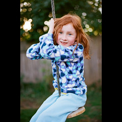 Swinging (dmacphoto) Tags: california red film girl childhood tallulah youth ginger kid backyard nikon child play kodak daughter young f100 rope ishootfilm swing redhead getty freckles redhair portra gettyimages fairoaks filmisnotdead danielmacdonald dmacphoto danielmacdonaldphotographer dmacphotocom gettyimagesdmacphotodmacphotocomdanielmacdonaldphotographer