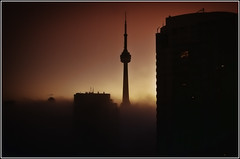 Foggy Sunrise (Matt Lazzarini) Tags: morning sky orange sun toronto ontario canada tower fog cn sunrise cntower olympus panasonic condos oly cityplace uwa blogto panny superwide gh1 flickraward thisphotorocks flickrestrellas spiritofphotography 918mm panasonicgh1 flickrunitedaward