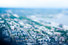 Looking to the north (daniellih) Tags: road seattle street city summer urban house blur building june modern buildings observation landscape 50mm miniature blurry nikon downtown cityscape dof view bokeh top space free shift deck needle ave tiny spaceneedle scape tilt urbanscape 2012 lensing tiltshift d90 freelensing daniellih