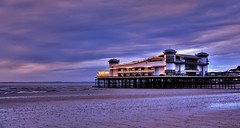 Glowing Pier (Mike Dorey) Tags: new uk greatbritain light sunset england sky sun english beach architecture clouds buildings reflections landscape coast pier seaside lowlight sand nikon britain dusk offshore sigma somerset coastal coastline weston brittish d90 englishness ukcoast