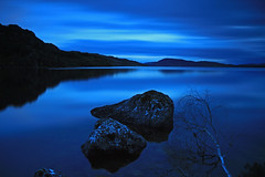 Loch Blue. (Gordie Broon.) Tags: longexposure blue summer tree nature water clouds reflections landscape geotagged photography scotland scenery rocks alba capital scenic escocia reservoir hills highland inverness schottland ecosse invernessshire scottishhighlands dunlichity lochduntelchaig canoneos7d bunachton bestcapturesaoi gordiebroon