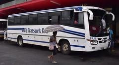 Fiji transport (D70) Tags: woman fiji umbrella hino lautoka