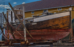 Going for rehab.... (Siggi007) Tags: ocean wood old blue sea sky sun seascape colour water colors beautiful norway clouds yard canon 50mm coast boat photo wooden seaside fishing rust paint flickr sailing ship foto view outdoor awesome details picture rusty vessel colores repair bergen shipyard upgrading rehab farben fotografi improve replacing canoneos6d