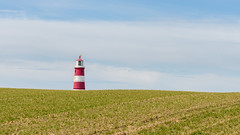 Over the hill (davepsemmens) Tags: lighthouse spring norfolk happisburgh happisburghlighthouse