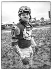 Jockey at Pimlico Racetrack in Baltimore (crabsandbeer (Kevin Moore)) Tags: horses people horse man sports rain weather race speed dof mud action goggles maryland baltimore event preakness jockey ponies muddy pimlico horserace horseman mudder marylandsports