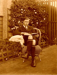 "Teenage boy reading a book in the garden, 1910-1920, Queensland, Australia • <a style=""font-size:0.8em;"" href=""http://www.flickr.com/photos/81015582@N06/7430737246/"" target=""_blank"">View on Flickr</a>"
