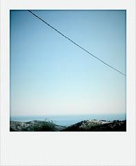 POLAROID (Enrico Lo Storto) Tags: color polaroid mare estate cellulare telefono colori viaggio sabbia bimbi nubi ombrellone viaggiare mappamondo cartinageografica cameraphoneurban enricolostorto