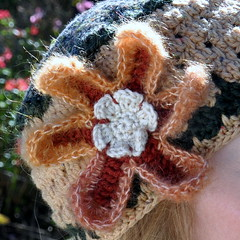 With a big crocheted flower (Kiwi Little Things) Tags:
