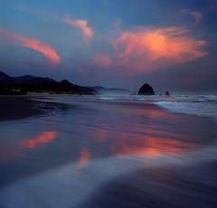 Returnings (Zeb Andrews) Tags: ocean sunset color film beautiful clouds oregon square landscape coast surf waves hasselblad pacificocean pacificnorthwest oregoncoast cannonbeach haystackrock westcoast bluemooncamera kodakektar100