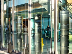 glass & steel (Harry Halibut) Tags: blue canada reflection building london glass yellow silver shopping square steel centre arcade wires wharf round canary posts stainless allrightsreserved struts cylindrical tensions colourbysoftwarelaziness 2012andrewpettigrew antramming cylinderer london1207062377